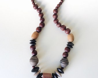 Vintage wood bead necklace / unique 70s large chunky statement necklace / muted neutral color beads blue yellow red black gray brown, tan