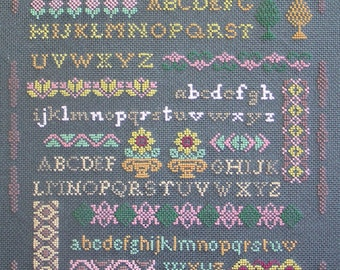 A gray background with stitch alphabet embroidery
