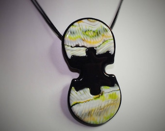 Necklace with two circles joined together by a piece of puzzle