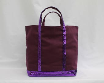 The purple round glitter tote bag purple