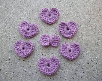 A crocheted purple cotton bow and 6 hearts