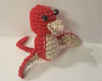 Crocheted red bird creature