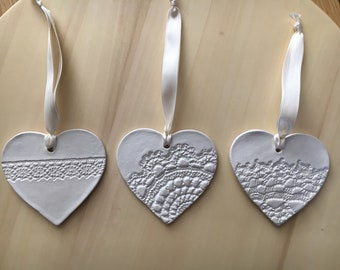 Clay heart hanger with lace design 8cm across