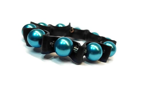 Black rubber bracelet with blue beads from hand-cut bicycle inner tubes