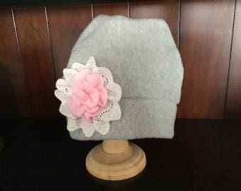 Child's fleece hat with flower and lace