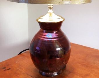 Small dark brown copper handmade wheel thrown lamp with brass hardware