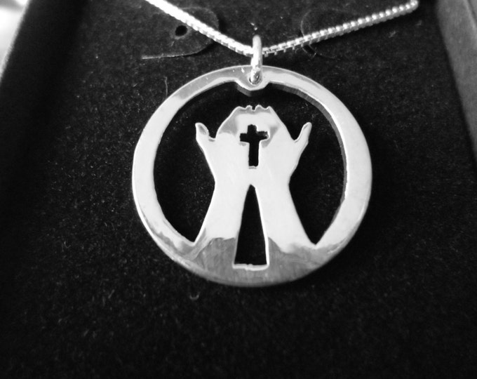 Hands w/ cross necklace quarter size w/sterling silver chain