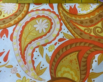 "Fleurish by Valori Wells for Free Spirit. Gold and orange paisley wirh fall leaves. Remnant measures 17x42""."