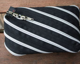 silver and black diagonal zip pouch