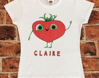 Childrens' personalised, custom and bespoke hand-drawn t-shirt with strawberry motif. Wording and colours of your choice.