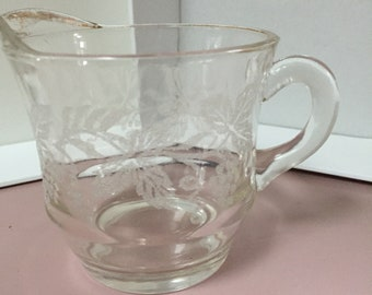 Etched vintage creamer container