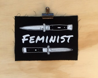 Feminist Switchblade Patch screen printed black canvas