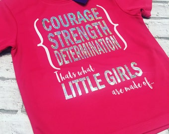 Courage, strength, determination. That's what little girls are made of. Coolfit Tee