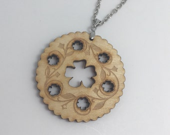 Wood Dorcas pin tin inspired acrylic necklace pendant Laser cut from acrylic. by Emily M A Parkin