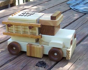 Handmade wooden toy fire truck.