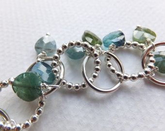 Silver bracelet with heart-shaped tourmaline beads.