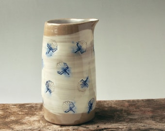 Pourer with leaf design in buff, white and blue