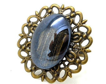 Fancy ring bronze, black cabochon Golden charms and co.