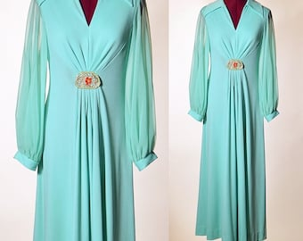 1960's authentic vintage Sea Foam Green polyester maxi dress gown with sheer long sleeves and burnt orange buckle detail women's size small