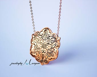 Handmade floral etched copper necklace
