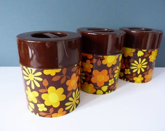 Vintage tins canisters flower power