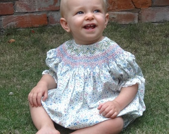 Cute smocked Romper - size 6 - 9 months, floral fabric with pink and blue pastel smocking