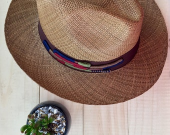 Type Panama Hat, woven with Toquilla straw and applique in neutral colors.