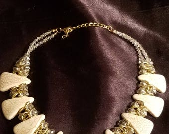 White, silver and gold necklace