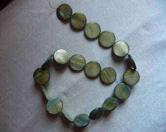 Beads, Mother of Pearl 20mm Flat Round Coin, Shades of Green.  Sold per 15 inch strand. There are 20 beads on the strand.