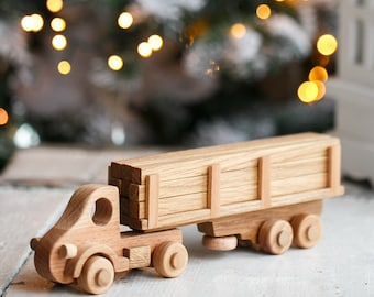 A toy logging truck with logs. Material: beech, oak. Handmade. Complete set comes with 9 logs. Wooden toy truck with Trailer. wood car