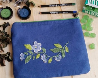 Hand-embroidered blue clutch with cross stitch
