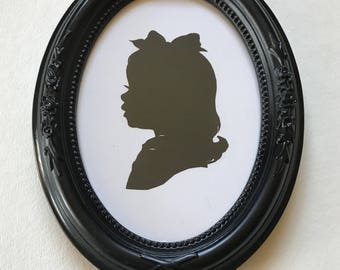 FRAMED Custom Silhouette in Black Oval with Rose Accents