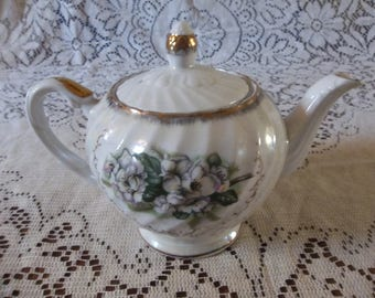 Iridescent white teapot with swirl sides