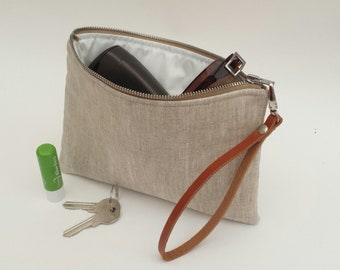 Clutch bag in neutral linen effect matt oilcloth with detachable leather wristlet strap, 100% waterproof & wipe clean, wet bag
