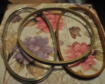 Three vintage metal embroidery hoops