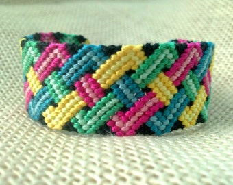 Friendship Bracelet - Black, Blue, Green, Red and Yellow Braided Pattern