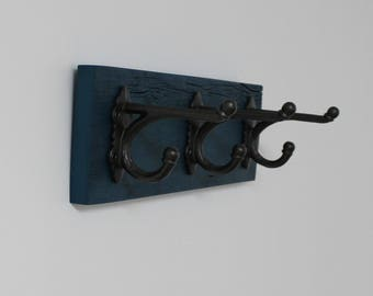 Wall hook made of recycled wood with hooks to harness