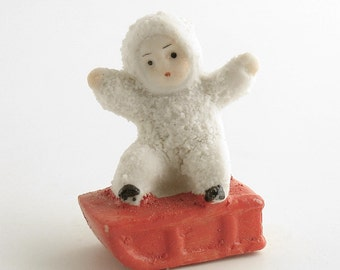 Vintage Christmas Decoration Snow Baby on Sled