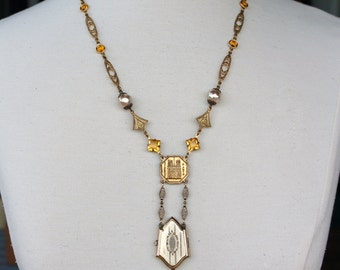 Antique Assemblage Necklace with Shield Shaped Locket in Gold and Yellow
