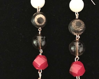 Earrings made with a beautiful assortment of beads (agate, quartz, and glass)