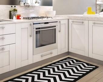 Black and white chevron area rug, printed linoleum rug, vinyl mat. Art Mat with zigzag geometric design.