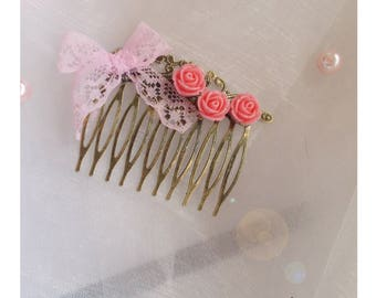 dressed in rose bronze hair comb and a lace bow pink