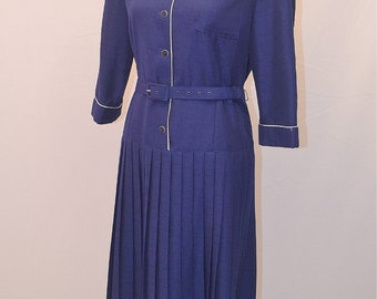 1980s Eastex navy dress with white piping detail and pleated skirt