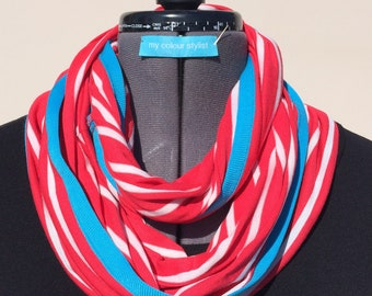 Stripe vicose jersey infinity scarf in bright watermelon and edged with turquoise jersey binding.
