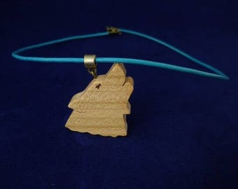 cherry wood and blue leather Wolf pendant