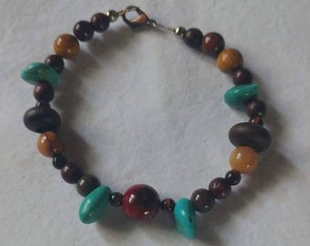 Turquoise, wood and red tigars eye bracelet. Earth tones. Native American style. Wood beads. One of a kind.