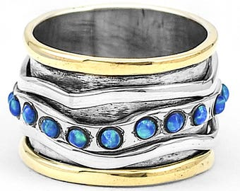 Meditation with Opal ring, sterling silver and gold size FR 54. Size US 7 opal sterling silver spinner ring. Two tones ring