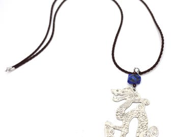 Pendant necklace, dragon, German silver, silver metal pattern. Lapis lazuli and Garnet. Dark brown cord.