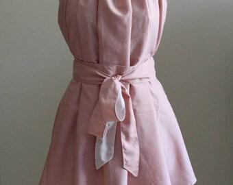 Sleeveless cotton blouse.