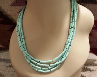 Four strand beaded tube turquoise necklace